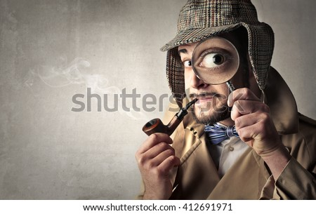 Retro dressed detective Royalty-Free Stock Photo #412691971
