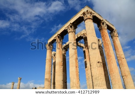 The Parthenon of the Acropolis on a background of blue sky and clouds, Greece  #412712989