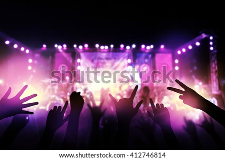 Audience with hands raised at a music festival from above the stage at live concert luxury party. #412746814