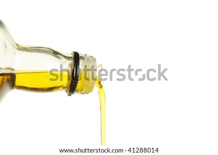 Closeup of olive oil pouring from a glass bottle #41288014