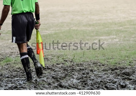 Soccer assistant referee with flag. #412909630