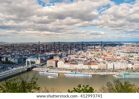 Beautiful panorama of Budapest city with Danube river, bridges and boats, Hungary. Cityscape with blue sky and gorgeous clouds. #412993741