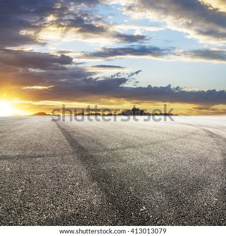 Sunset asphalt asphalt tire marks #413013079
