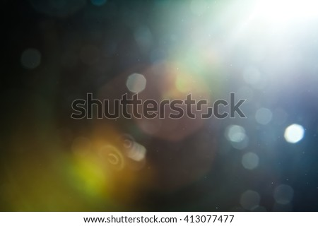 Real Lens Flare Shot in Studio over Black Background. Easy to add as Overlay or Screen Filter over Photos Royalty-Free Stock Photo #413077477