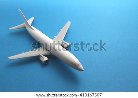 Toy airplane on blue background.