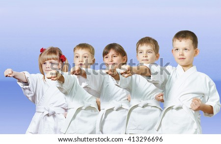 Children are hitting a punch on a light background #413296696
