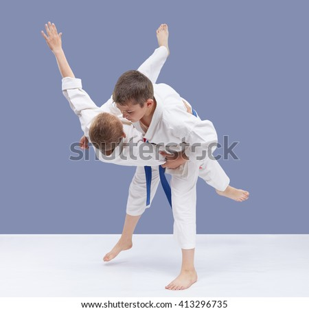 Boys are trained judo throws  #413296735
