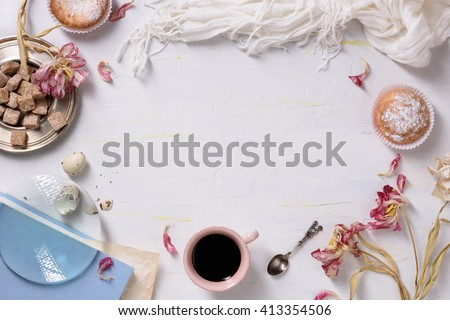 Cupcakes and coffee, morning light, food frame. Valentines or wedding day breakfast. Copy space, top view. #413354506