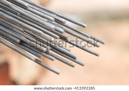 Using steel wire for securing steel bars with wire rod for reinforcement of concrete or cement. focus to steel wire #413392285