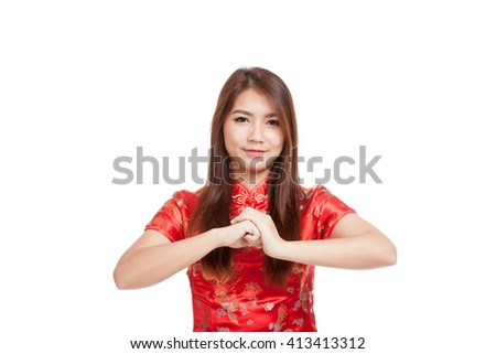 Asian girl in chinese cheongsam dress with gesture of congratulation  isolated on white background #413413312