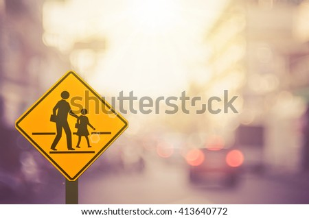 Traffic sign,school sign on blur traffic road abstract background.Retro color style.