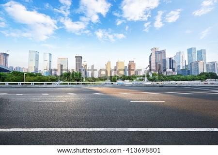 Asphalt road and modern city #413698801