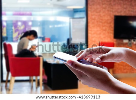 Girl use mobile phone, blur image of inside coffee bar use for background. #413699113