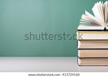 Open book, hardback books on wooden table. Education background. Back to school. Copy space for text. #413724160
