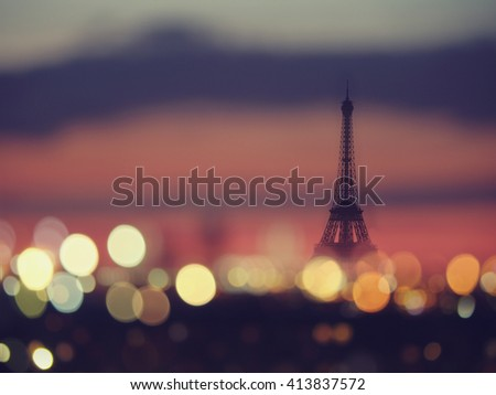 Silhouette of Eiffel tower and night lights of Paris, France. Vintage style travel background #413837572