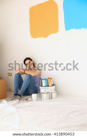 Young woman portrait while painting new apartment  #413890453
