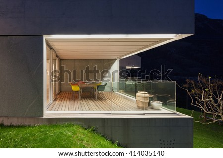 Architecture modern design, concrete house, lit terrace at night #414035140