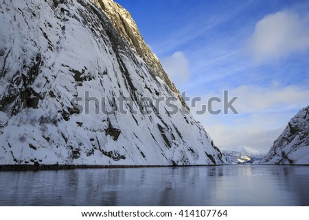 View of Trollfjord with snow-capped mountains on Lofoten Islands, Nordland, Norway #414107764