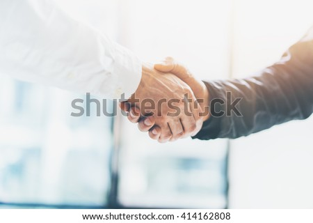 Business partnership meeting. Picture businessmans handshake. Successful businessmen handshaking after good deal. Horizontal, blurred background #414162808