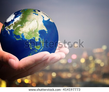 The world is on hold for the city bokeh blur background.  Elements of this image furnished by NASA. #414197773