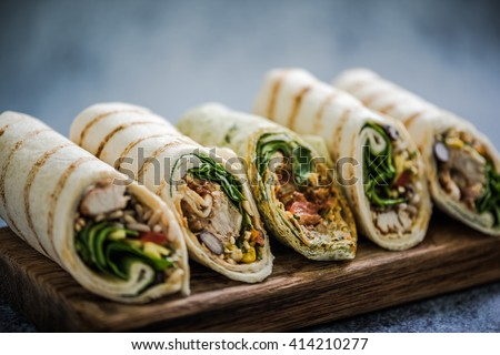 Mexican fajita wraps on serving board, copy space for text or menu Royalty-Free Stock Photo #414210277