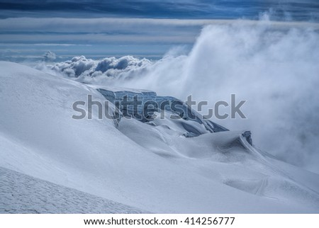 Dramatic clouds gathering in high altitude near top of Huayna Potosi mountain in Bolivia #414256777