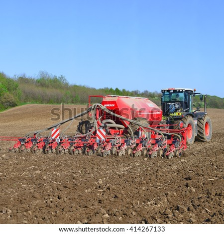Kalush, Ukraine - April 18: Planting corn trailed planter in the field near the town of Kalush, Western Ukraine April 18, 2016 #414267133
