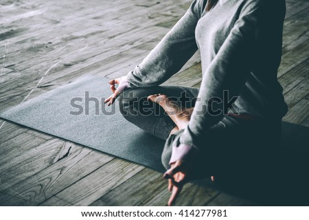 Young woman meditates while practicing yoga. Freedom concept. Calmness and relax, woman happiness. Toned picture