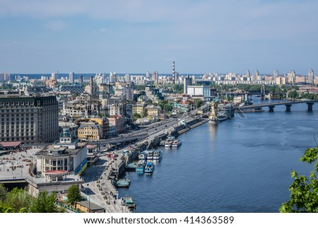 KIEV, UKRAINE - MAY 1, 2016: Kiev cityscape: view of Podil and River Dnieper. Kiev is capital of Ukraine and one of oldest cities of Eastern Europe. Kiev was founded in late 9th century. #414363589