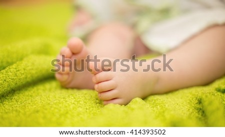 Newborn Baby legs on the bed #414393502