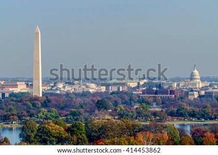 The Washington Monument and United States Capitol Building stand tall amongst the fall landscape of Washington D.C.