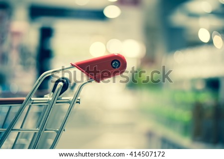 Shopping cart or trolley on department store bokeh background #414507172