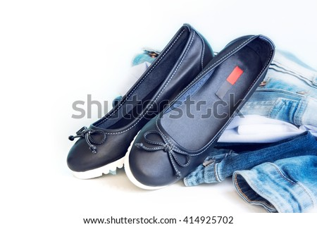 Loafers sleep on female leather blue shoes on white background empty space for text.Jeans clothes & footwear set. #414925702