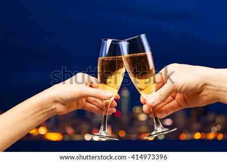 Man and woman hands with champagne glasses #414973396