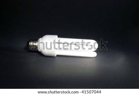 Electric bulb on black background with white light #41507044