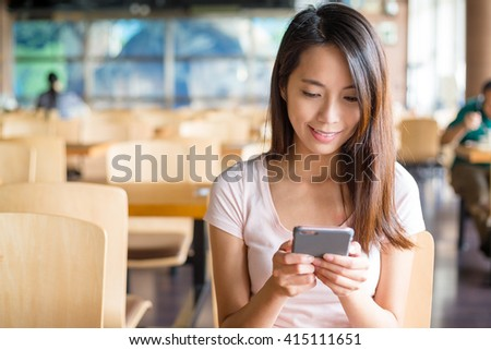 Woman look at cellphone #415111651