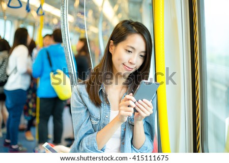 Woman use of mobile phone #415111675