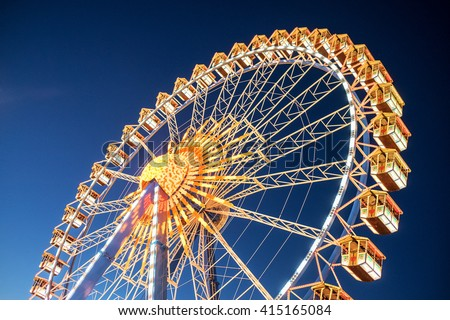 famous ferris wheel at the oktoberfest in munich - germany Royalty-Free Stock Photo #415165084