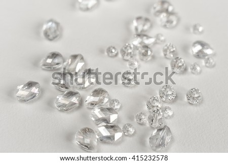 Glass transparent brilliant beads on a white background #415232578