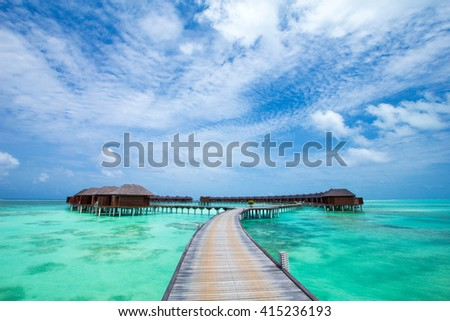 beach with water bungalows at Maldives #415236193