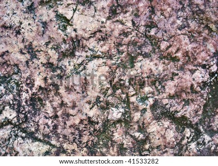 Granite pattern. Outdoor photo (with small trace of moss) #41533282