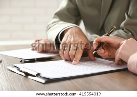 Human hands working with documents at the desk closeup Royalty-Free Stock Photo #415554019