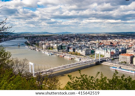 Peautiful panorama of Budapest city with Danube river, bridges and boats, Hungary. Cityscape with blue sky and gorgeous clouds. #415642519