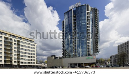 VILNIUS, LITHUANIA - MAY 04, 2016: Big shopping center Helios City. grocery supermarket Norfa and elite apartments in a penthouse on Savanoriu ( Defenders of Freedom ) Street. Sunny sprig day #415936573
