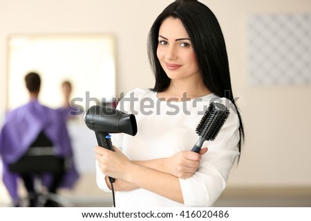 Professional hairdresser with comb and hairdryer #416020486