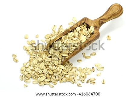 wooden scoop with oatmeal isolated on white background #416064700