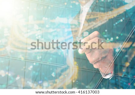 Double Exposure of Businessman writing with Building decorated with Glass #416137003