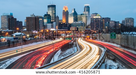 Heavy traffic flowing in and out of Minneapolis just after sunset, on a cold winter evening.