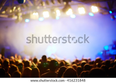 Blurred background with crowd at the concert
