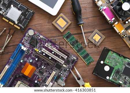 Electronic circuits on wooden table, top view #416303851